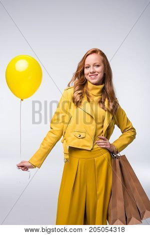 Girl In Yellow Jacket With Balloon