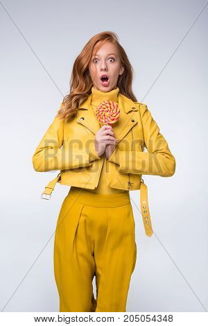 Shocked Girl In Leather Jacket With Lollipop