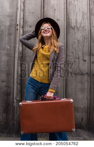 Redhead Girl With Vintage Suitcase