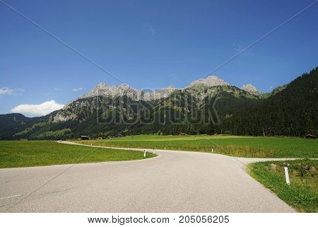 Road in the Tyrolean Alps in the direction of the Mount Red Flueh