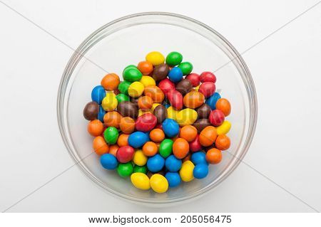 colored sweets, peanuts covered with chocolate, multicolored sweets, round candies