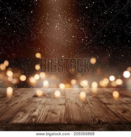 Festive background with golden bokeh and light point for a christmas decoration