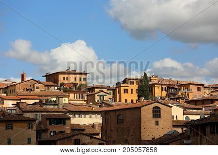 Beautiful Landscape The Roofs Of Houses Of Europe Sienna Old Town In Italy Under Blue Sky With Cloud