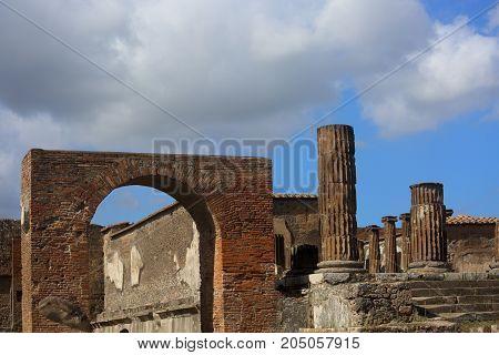 Old Historic Ruin Pompey Town Near The Vesuvius Volcano. In Sunny Day Under Blue Sky
