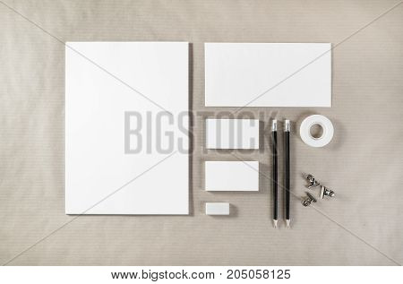 Photo of blank stationery. Corporate identity template on paper background. Mock up for design portfolios. Top view.