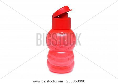 Close up bright red plastic bottle for kids