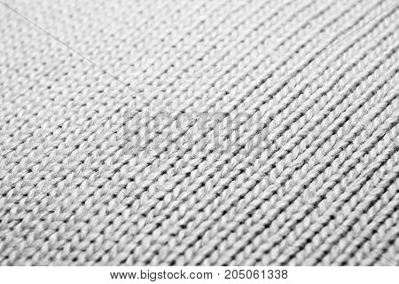 Texture of knitted fabric. Stranded threads. Cloth of warm winter clothes. Blurred.