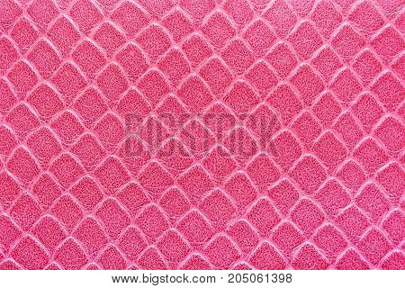 Texture of artificial skin pink color. Pattern of a rhombus. Bright colors.