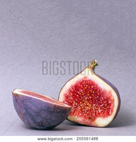 figs cut into two parts. Juicy fruit. Bright colors. Blurred background.