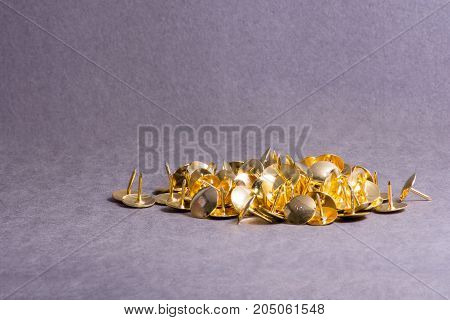 Thumbtacks on gray background. Stationery. Business concept.