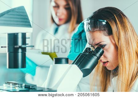 Biotechnology , Toned Image, Two Women Research In The Lab