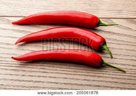 chili pepper on a wooden table, red pepper, hot chili pepper