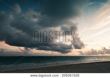 Dramatic Dark Stormy Clouds In Sunrise