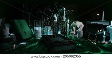 Witchcraft composition with burning candles, human skull, magic book, jewelry, tarot cards and pentagram symbol. Halloween and occult concept, black magic ritual.