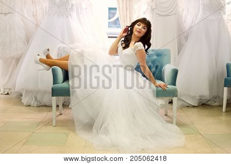 Bride sits on a light blue sofa
