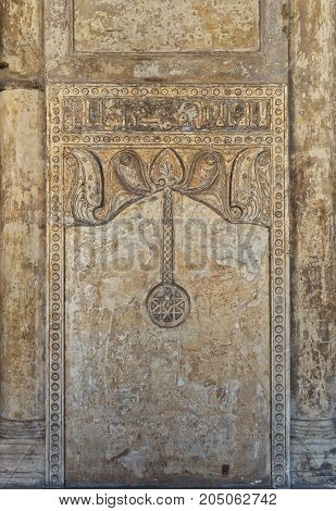 Cairo, Egypt - September 16, 2017: Ornate engraved stone wall with floral patterns and calligraphy Ibn Tulun Mosque Cairo Egypt