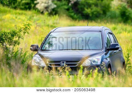 ROSTOV-ON-DON, RUSSIA - CIRCA 2017: Honda CR-V third generation in grass outdoors