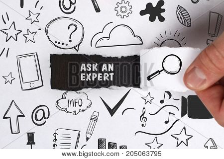 Business, Technology, Internet And Network Concept. Young Businessman Shows The Word: Ask An Expert