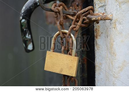 Lock with rusty chain prevent  the crime