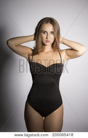 Oversized caucasian young model, studio portrait shot