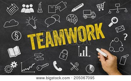 Teamwork Written On A Blackboard With Icons