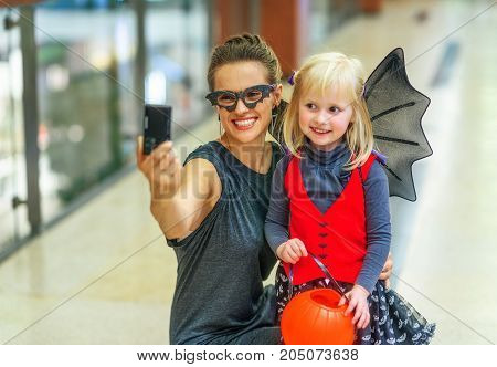 Mother And Child With Digital Camera Taking Selfie