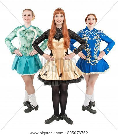 Three Beautiful women in dresses for Irish dance isolated on white