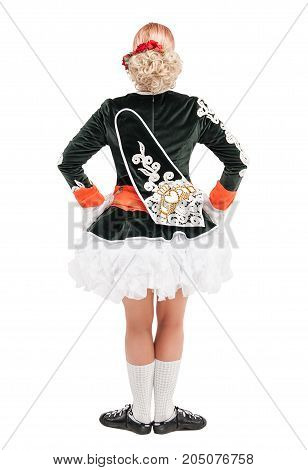 Beautiful woman in dress for Irish dance back pose isolated on white