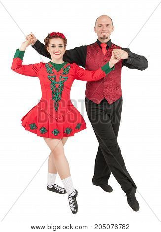 Beautiful couple Irish dancers isolated on white