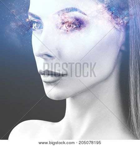 Double exposure of beautiful woman face and cosmic galaxy. Elements of this image furnished by NASA.