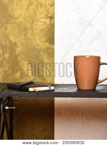 Tea Or Coffee Cup With Copybook And Pen