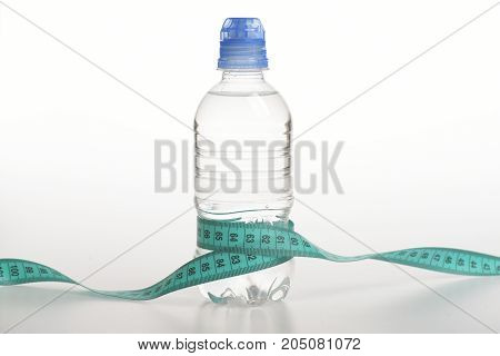 Water Bottle Tied With Cyan Measure Tape On White Background