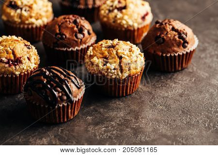 Different homemade muffins, selective focus. Copy space.