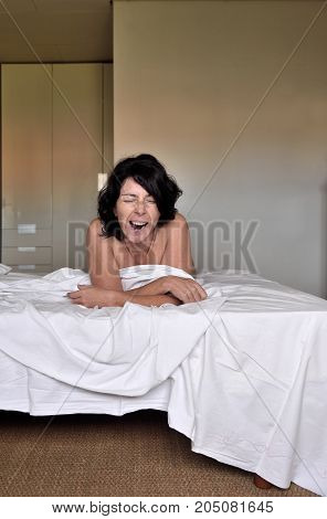 portrait of a yawn woman on the bed