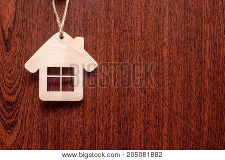 House symbol on a brown wooden background