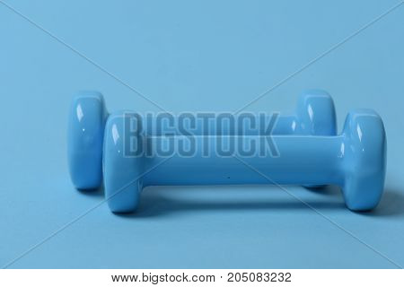 Health Regime And Fitness Symbols. Dumbbells Made Of Blue Plastic