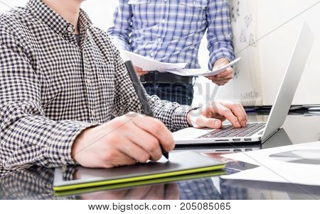 Colleagues interact during their workflow in office