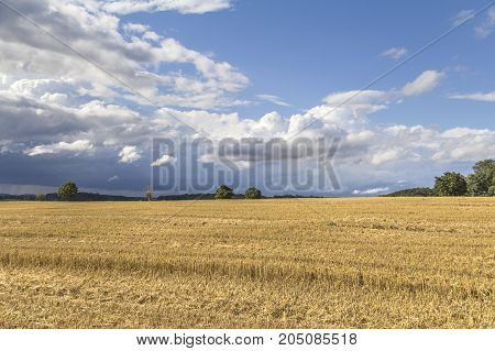 a clouded sky in rural agricultural ambiance