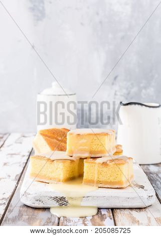 Traditional homemade baked pudding cake with custard cream. Healthy dessert. Product photography for patisserie or restaurant with copy space.