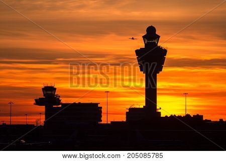 Plane taking off from Schiphol international airport at sunset. Amsterdam The Netherlands