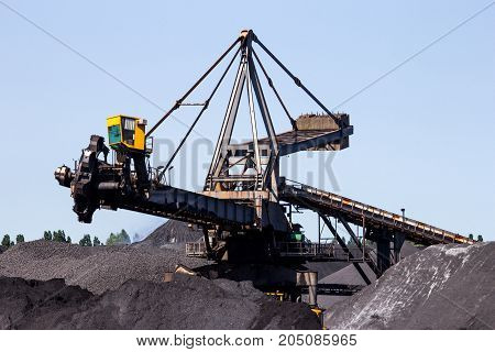 Stacker reclaimer in a coal handling terminal.