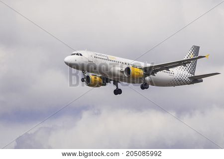 LONDON UK - AUGUST 6 2013; A Vueling Airbus A320 lands at Heathrow airport in London.