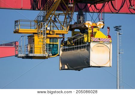 ROTTERDAM THE NETHERLANDS - JUL 9 2013: Harbor gantry crane moving a tank container