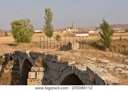 Roman bridge and village of Sasamon Burgos province Spain