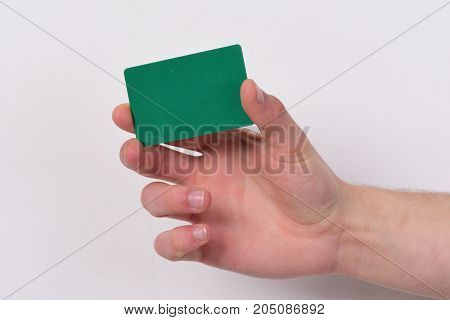 Male Hand Holds Dark Green Card. Piece Of Paper