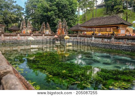 Bali Indonesia - September 92017: People visit Holy water spring in the Pura Tirta Empul Bali Indonesia
