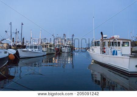 New Bedford Massachusetts USA - May 30 2007: Fishing boats moored along New Bedford wharves
