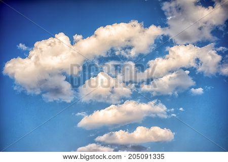 white clouds in a blue sky in a daytime