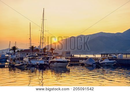 Beautiful Sunset At The Harbour. Yachts In Port With Mountains On The Background. Tivat, Montenegro.