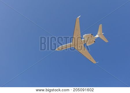 White jet plane in the blue sky